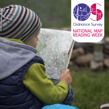Child reading a map. The Ordnance Survey logo is in the top right.
